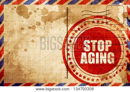 stop aging, red grunge stamp on an airmail background