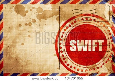 swift, red grunge stamp on an airmail background