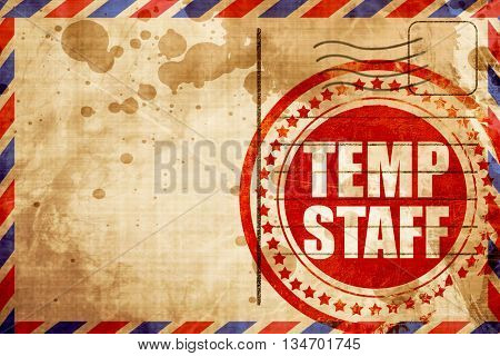 temp staff, red grunge stamp on an airmail background