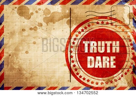 truth or dare, red grunge stamp on an airmail background