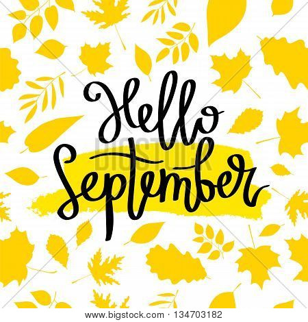 Hello September. The trend calligraphy. Vector illustration on a beautiful background of golden autumn leaves. Smear of yellow ink. Concept autumn advertising.