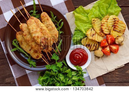 Grilled meat on a skewer - lula kebab. The traditional dish of the Caucasus Central Asia and Turkey. Grilled vegetables.The top view