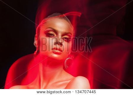 Art Fashion Make Up Photo. Woman With Fire Type Flames Arround Her