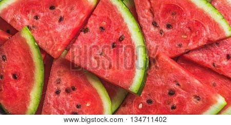 Sliced red ripe watermelon. Fruit background and texture