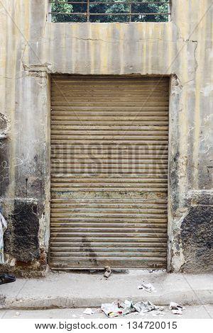 Closed shop, Corrugated old door closed .