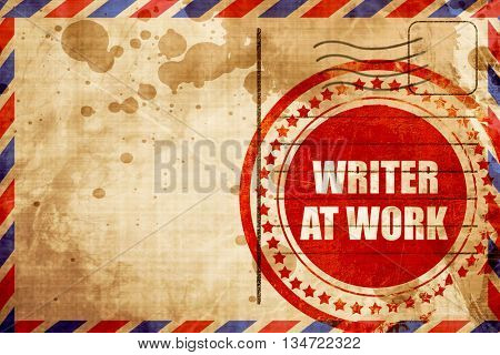 writer at work, red grunge stamp on an airmail background