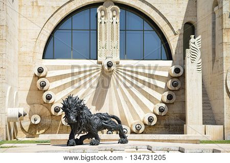 YEREVAN ARMENIA - MAY 2016: statue of a lion on a complex cascade of stairs in the center of Yerevan.