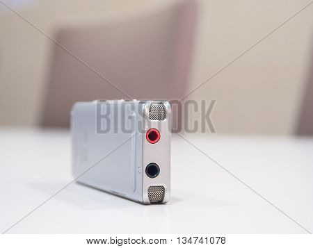 Dictaphone On White Table While Business Meeting
