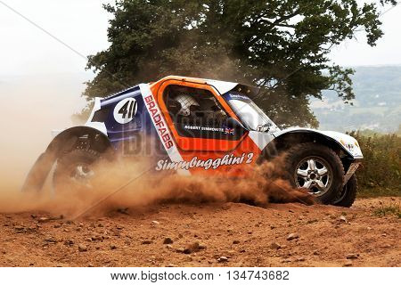 WULSTAN, UK - JULY 21: An unnamed driver exits the last corner on the course before heading toward the finish line during the AWDC UK Brit Part Comp Safari competition on July 21, 2013 in Wulstan.