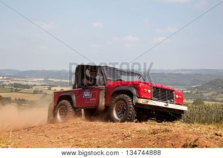 WULSTAN, UK - JULY 21: An unnamed driver reaches the top of the final hill climb before turning toward the finish line during the AWDC UK Brit Part Comp Safari competition on July 21, 2013 in Wulstan.