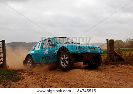 WULSTAN, UK - JULY 21: An unnamed driver negotiates the penultimate gate of the circuit before heading toward the finish at the AWDC UK Brit Part Comp Safari competition on July 21, 2013 in Wulstan.
