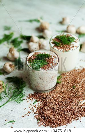 Glass Of Yogurt With Crushed Flax Seeds  On A White Background.
