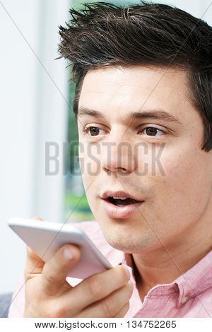 Man Using Internet Voice Search Technology On Mobile Phone