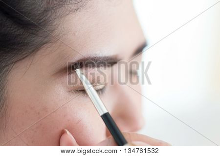 Makeup Beauty With Brush Eyebrow On Pretty Woman