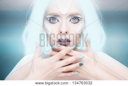 Snow queen with gel light blue nails and white hair and frozen makeup