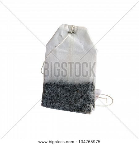 ordinary simple white paper tea bag of black tea with label isolated closeup on white background