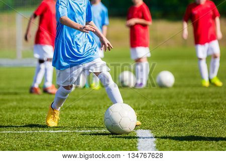 Children Playing Soccer Game on the Professional Football Pitch. Football Soccer Tournament for Youth Teams.