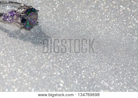 Fashion bracelet with mystic topaz rainbow topaz on glittering background. poster
