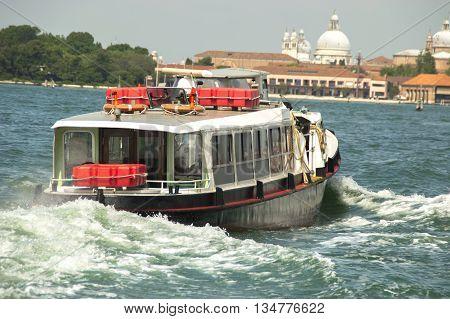 Vaporetto navigating in Venice lagoon opposite the city