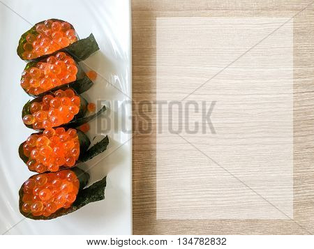 Salmon Roe (ikura) Gunkan Maki Sushi Serve On A White Plate With Cope Space On The Right