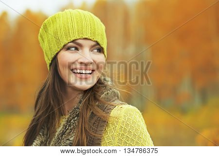 outdoor closeup portrait of a beautiful brunette middle aged woman