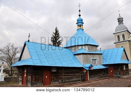 Dome wooden church of the Holy Trinity in the village Zabolotivka Chortkiv district in Ukraine. Built in the style of Cossack Baroque according to legend during the time of the Cossacks. Completed in 1646r. Near the new church.