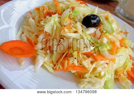 Cabbage and carrot salad close up view