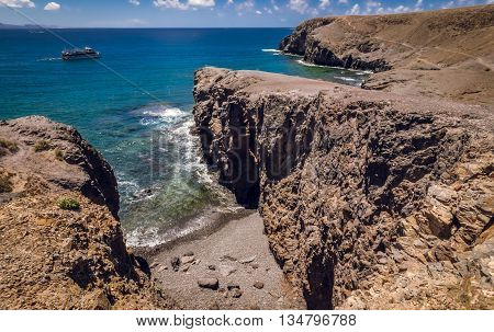 Aerial view of rocky cliffs above the Playa Mujeres in Lanzarote, Canary Islands, Spain