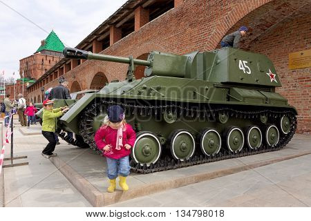 Nizhny Novgorod, Russia - May 3.2013. Children playing on the self-propelled artillery SU-76  at exhibition of military equipment of times of World War II in the Kremlin of Nizhny Novgorod.