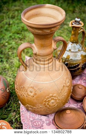 Jug from red clay. Beautiful handmade earthenware jug. Clay handmade jug.