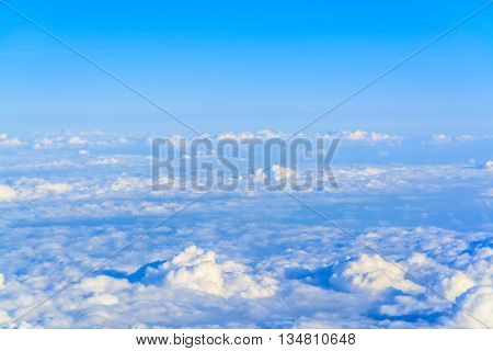 A fluffy blanket of cloud below a beautiful blue sky.