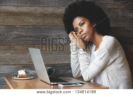 Attractive Fashionable Young African American Female With Clean Healthy Skin And Afro Haircut, Looki