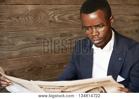 Handsome Successful African Corporate Worker With Stylish Moustache, Wearing Glasses, Reading News I