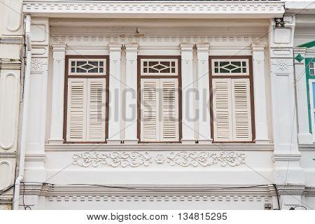 Classic windows Sino-Portuguese style architecture at Phuket Thailand. Vintage windows