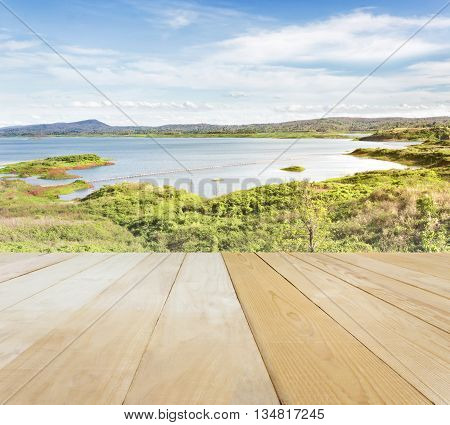 Blank Area Or Space Table Top On Wide Lake Or Reservoir With Puffy Clouds Blue Sky And Mountain In S