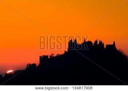 "Castle silhouette at sundown. Italian panorama from ""Marostica"". Orange sky poster"