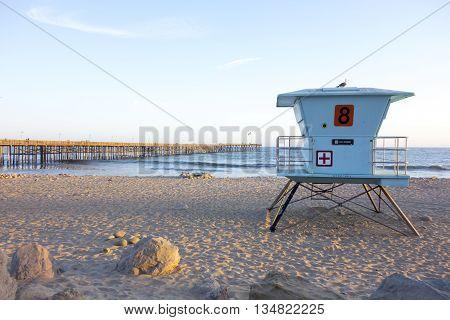 Lifeguard tower at San Buena Ventura city beach near historic wooden pier Southern California