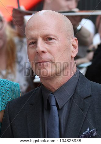 LONDON, UK, JULY 22, 2013: Bruce Willis attends the European Premiere of Red 2 at Empire Leicester Square picture taken from the street