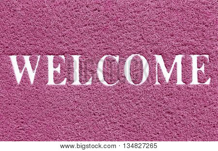 The doormat of welcome text on white background