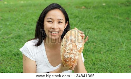Asian Woman Mature Adult Eating Bread Carbohydrates