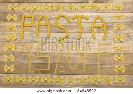 pasta fifteen percent off text made of raw pasta on wood