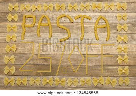 pasta twenty five percent off text made of raw pasta on wood