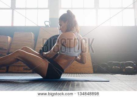 Fitness Woman Working Out On Core Muscles