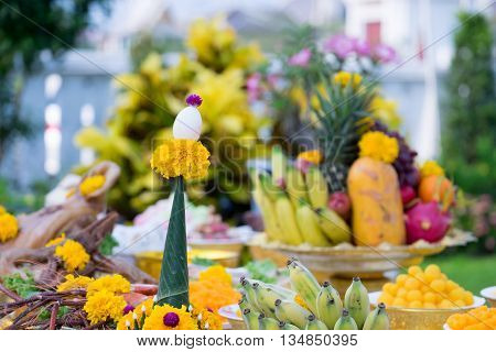 Boiled egg and Thai fruits decorated with flowers in ceremony to salute the Bangkok City Pillar ShrineThailand.