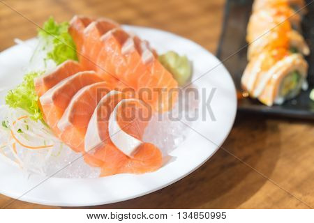 close up salmon sashimi on ice japanese style cuisine