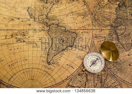 Beautiful old compass on vintage map background