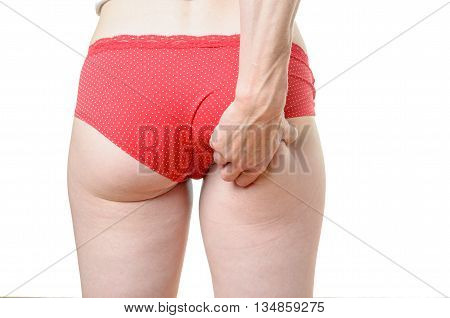 Young Woman Grabbing Excess Fat On Her Buttocks