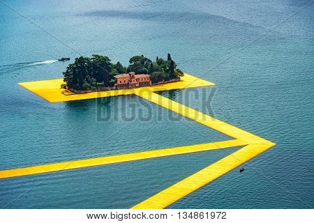 The Floating Piers. The Artist Christo Walkway On Lake Iseo St.paul Island.