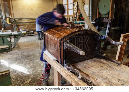 Carpenter Restoring Wooden Furniture In His Workshop