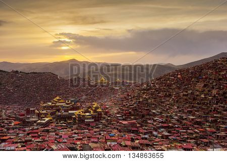 Monastery at Larung gar (Buddhist Academy) in sunset Sichuan China.